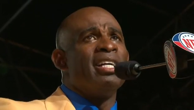 Photo shows Deion Sanders giving his emotional Hall of Fame Sppech. Sanders is also a dynamic motivational speaker and is one of our more popular athlete speakers says Sports Speakers 360.