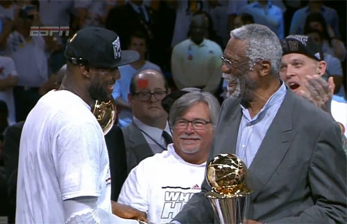 Photo shows NBA legend, Bill Russell , presenting the MVP  trophy to LeBron James after winning the 2013 NBA championship on June 20, 2013.