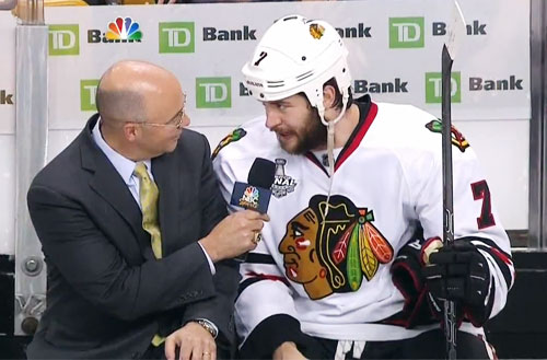 Chicago Blackhawks, Brent Seabrook , speakers with Pierre McGuire after his OT winning slapsot in Game 5 of the Stanley Cup Fonals against the Boston Bruins on June 18, 2013.