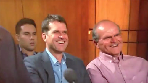 Photo shows Forty Niners coach Jim Harbaugh and his dad, Jjack having a good time at a taping of Judge Judy.