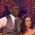Photo shows Keyshawn Johnson and Sharna Burgess after their first dance, the Cha-Cha-Cha, ready to receive the judges scores on DWTS Season 17.