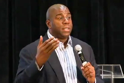 Photo shows magic Johnson speaking at the at the 2009 Diversity Alliance for Science Conference in NJ.