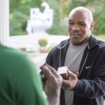 """Photo shows Mike Tyson returning Evander Holyfield's bitten ear  in an hilarious Foot Locker commercial titled """"All i is Right,"""" which fantasizes about a perfect world."""