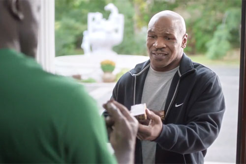"Photo shows Mike Tyson returning Evander Holyfield's bitten ear in an hilarious Foot Locker commercial titled ""All i is Right,"" which fantasizes about a perfect world."