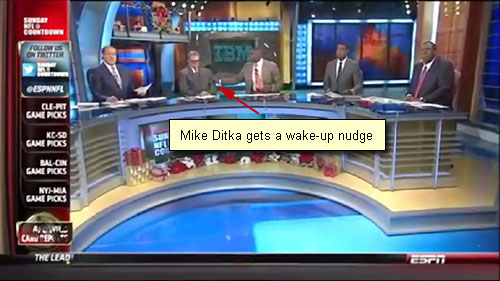 Photo shows Mike Ditka being nudged by Keyshawn Johnson after Ditka fell asleep on December 29th's ESPN's Sunday NFL Countdown.