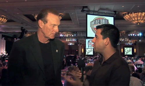 Photo shows Hall of Famer, Rick Barry, speaking to Harry Cicma in a 2011 interview..