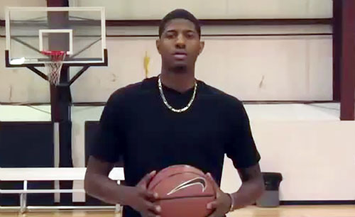 Photo shows Indiana Pacers All-Star, Paul George, in 2013  giving basketball tips on how to dribble.