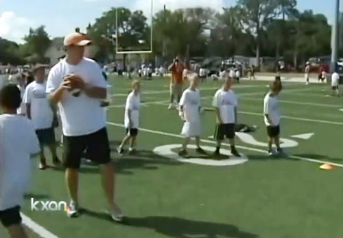 colt-mccoy-works-with-kids-procamp-austin-tx-jul-2012