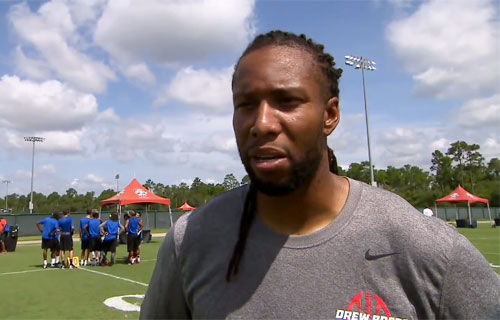 larry-fitzgerald-drew-brees-passing-academy-orlando-fl-jun-2014